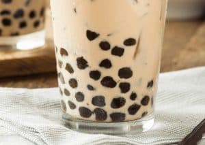 bubble tea in a tall glass on a napkin.