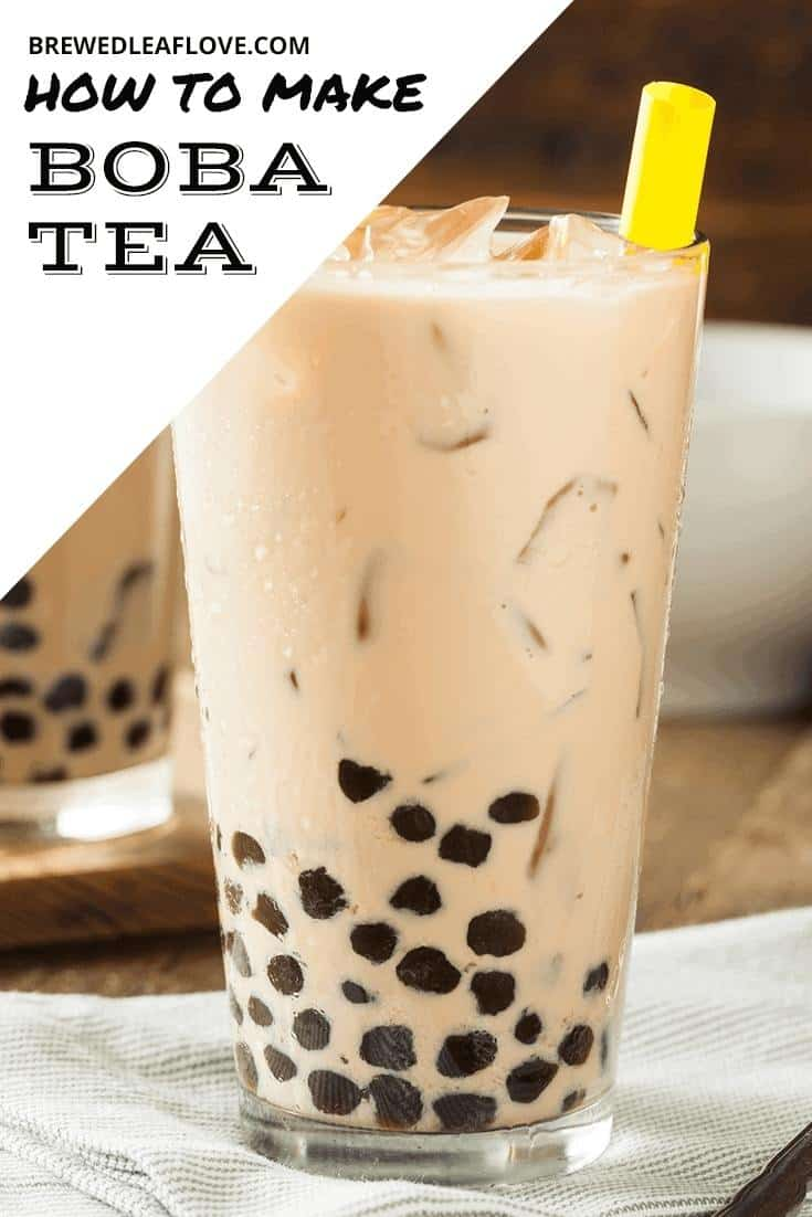 Bubble tea, or boba milk tea in a large glass with a yellow straw.