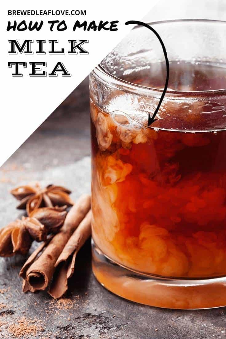 Glass mug of tea with swirling milk.  Cinnamon sticks and star anise.