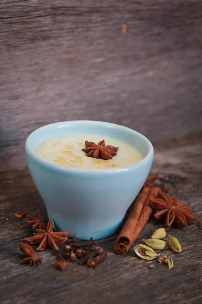 chai tea latte in a white cup with masala spices.