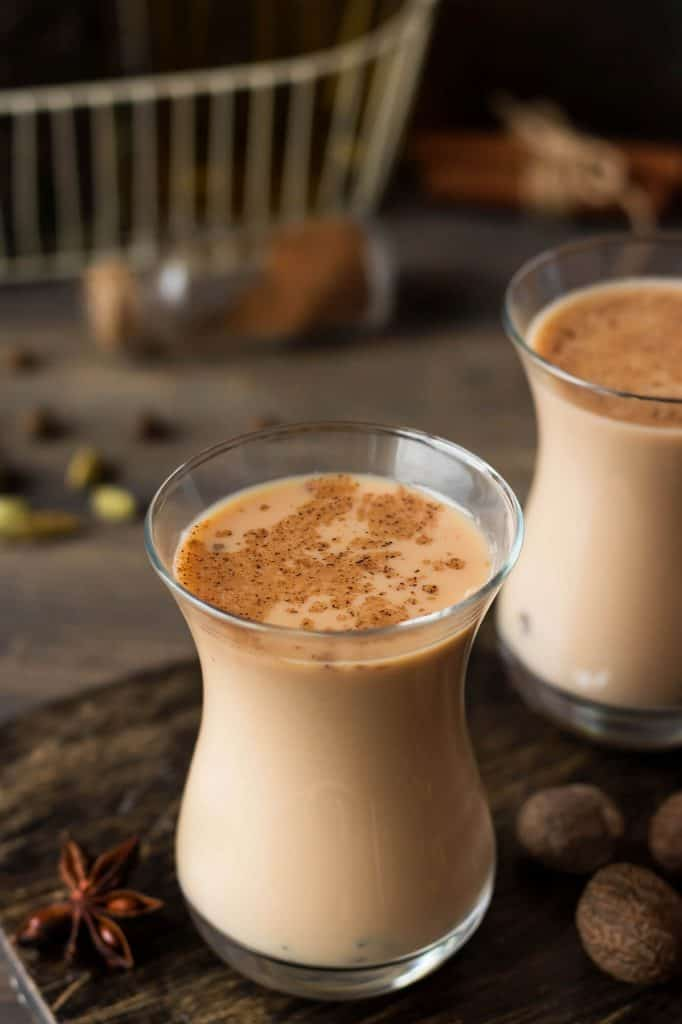 instant chai tea latte mix with hot water in a glass cup