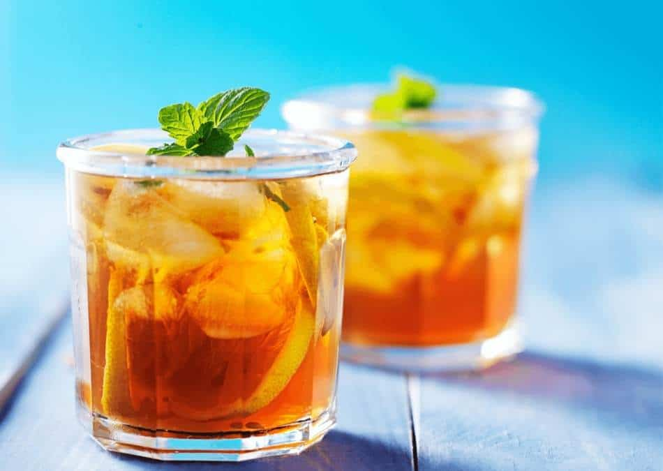 two glasses of southern sweet tea on a blue background