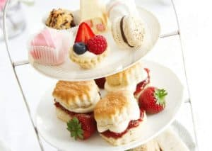 tea party food on a three tiered stand