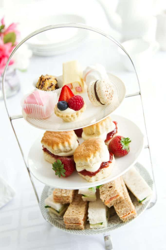 Three tier tray with tea party food.