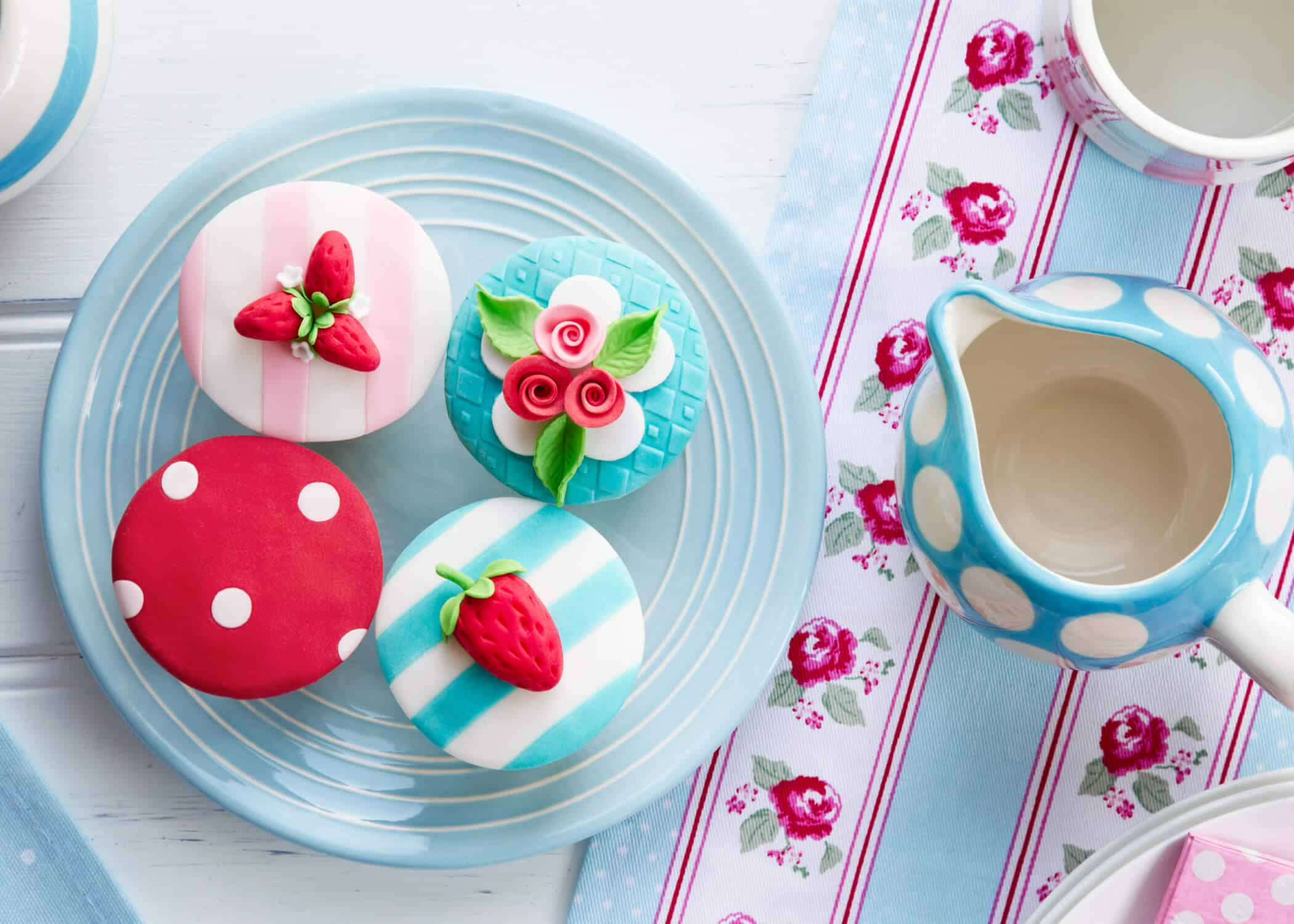 cupcakes and tea party ideas on a table