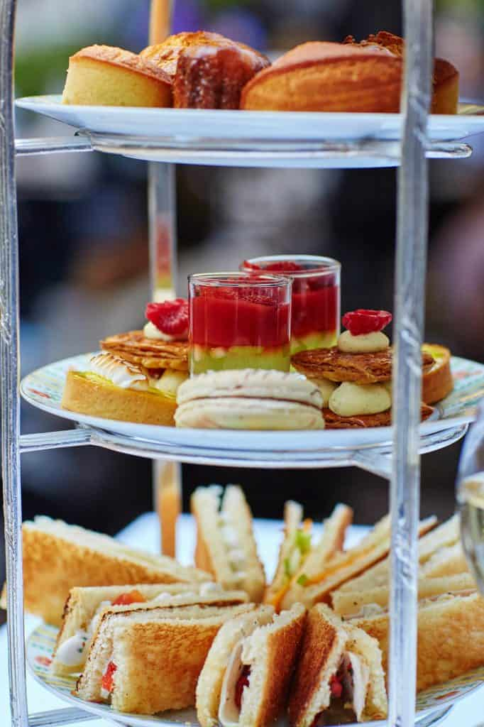 high tea meal on a three tiered tray