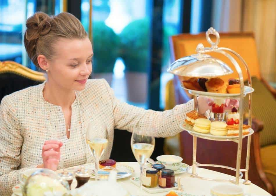 what is afternoon tea? A woman enjoying traditional afternoon tea