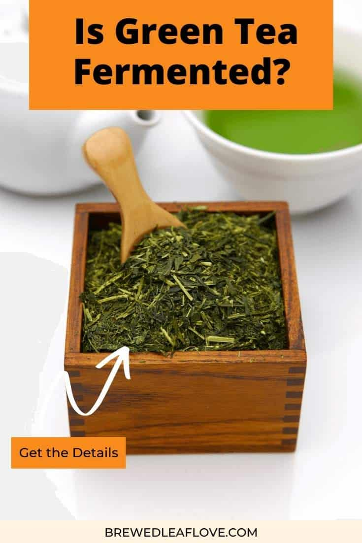 green tea fermented in a wooden box with a wood scoop.   White teapot with white teacup of brewed green tea.