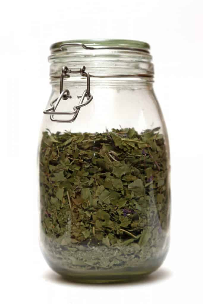 storing tea in a glass jars with a flip top glass lid and clamp