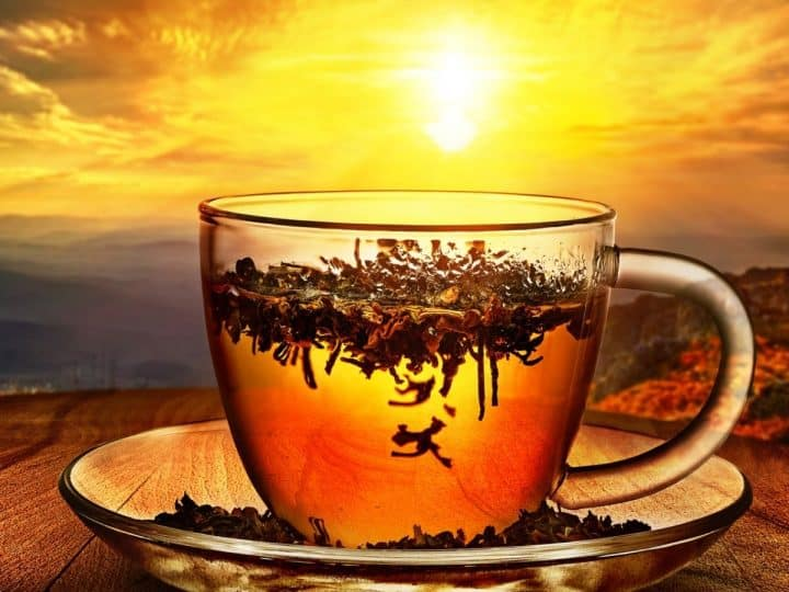 how to re steep tea with photo of glass teacup with sunrise background.