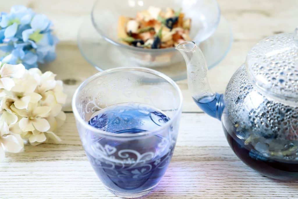 butterfly tea in a glass cup