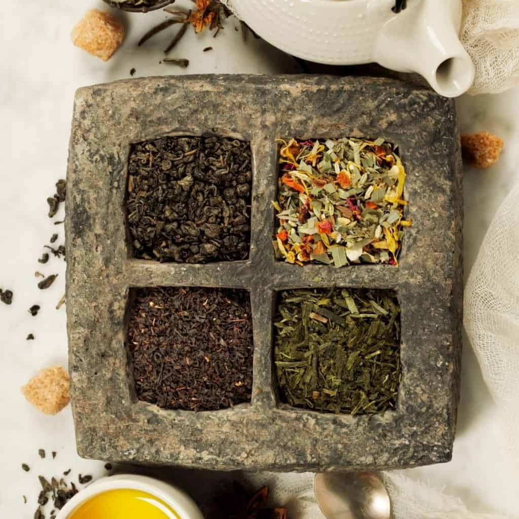 is black tea healthier than green tea different kinds of tea in a stone tray