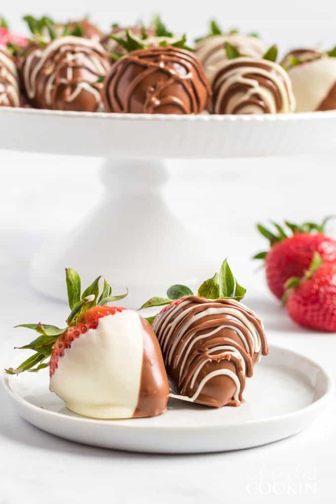 chocolate covered strawberries on a tiered tray